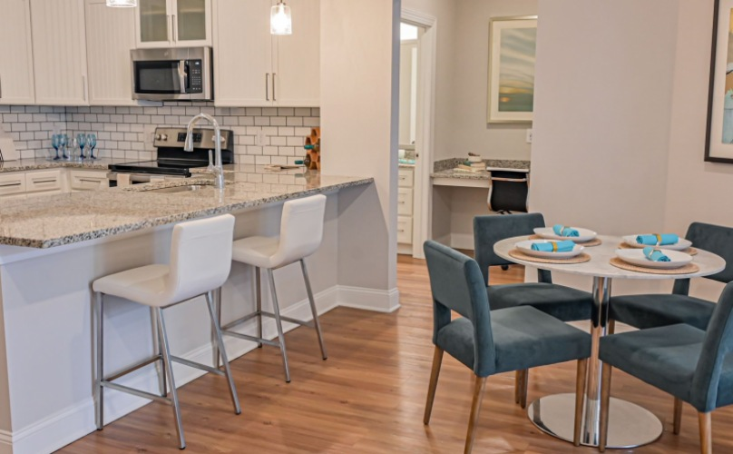 Kitchen and dining room space in your home at Hawthorne at Pine Forest in Oak Island, NC